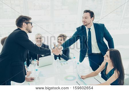 Business People Shaking Hands Successfuly  Finishing Up A Meeting