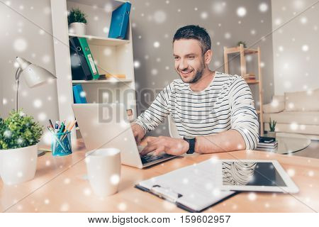 Handsome Man Working  On Laptop On Snowy Winter Background