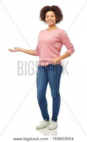 people, race, ethnicity and portrait concept - happy african american young woman holding something imaginary on hand over white