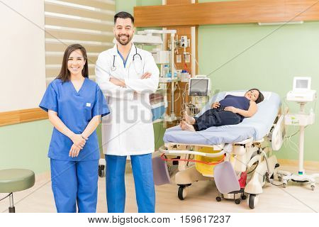 Doctor And Nurse With A Pregnant Patient