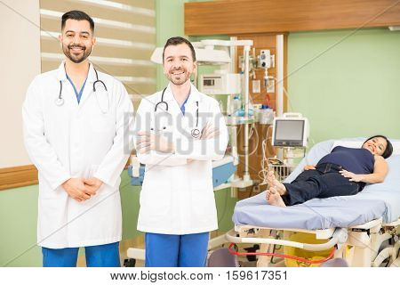 Doctors In A Hospital With Pregnant Woman