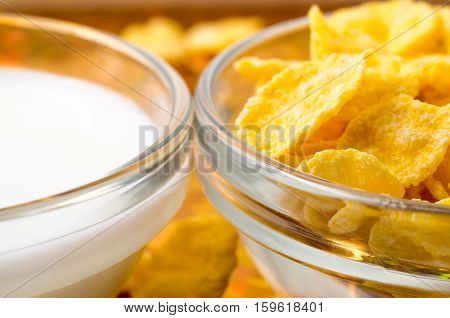 Transparent Cups With Milk And Cornflakes Close-up
