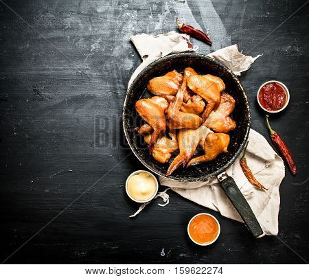 Smoked Chicken Wings In The Pan With The Sauce