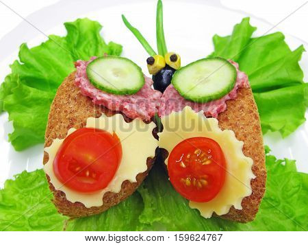 creative sandwich with cheese and salame butterfly shape