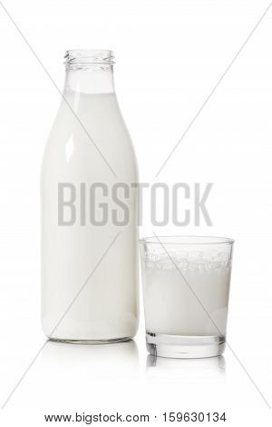 glass cup and bottle full of milk on white background