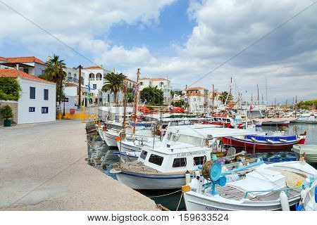 SPETSES ISLAND, GREECE - OCTOBER 4: Fishing boats in the old harbor on October 4, 2014 in Spetses island. A lovely island of the Saronic Gulf, Spetses island is a popular weekend destination.