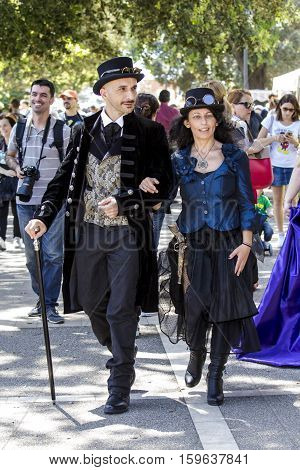 CAGLIARI, ITALY - May 29, 2016: Sunday at La Grande Jatte VIII Ed. At the Public Gardens - Sardinia - group of people parading in traditional Sardinian costume