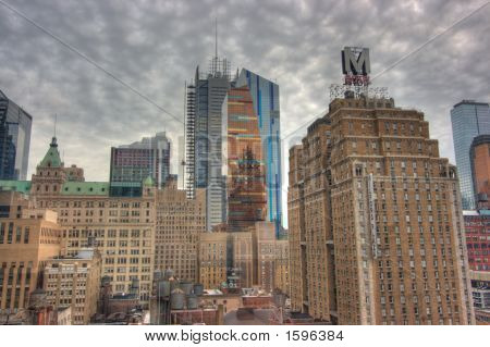 Downtown Skyscrapers In New York City Under The Clouds