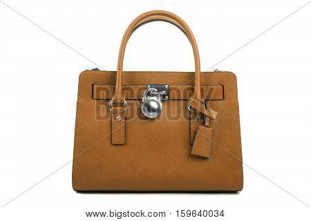 Ladies Brown leather handbag on white background