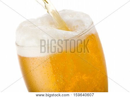 Beer Pouring Into Glass