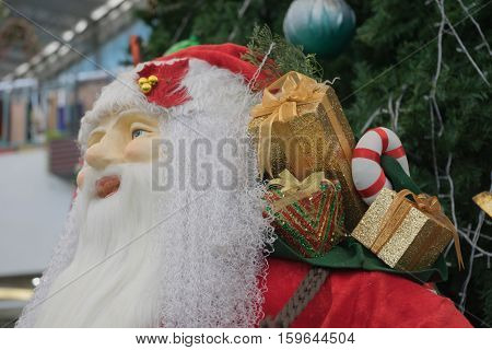 santa clsaus doll with colorful gift christmas gift outdoor with christmas tree / santa clsaus doll