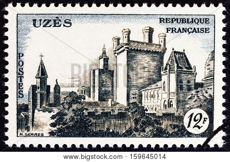 FRANCE - CIRCA 1957: A stamp printed in France shows Uzes Chateau, circa 1957.