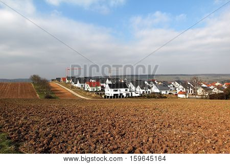New housing area for families/ New housing area for families in rural landscape.