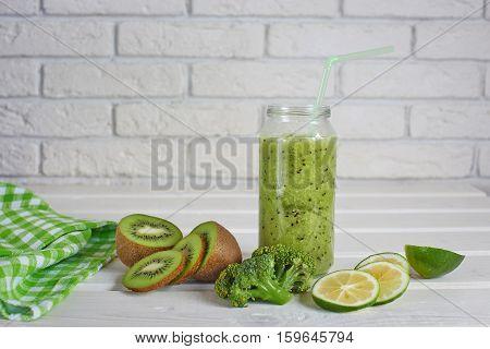 Smoothies of kiwi, Lemon and broccoli on a white background