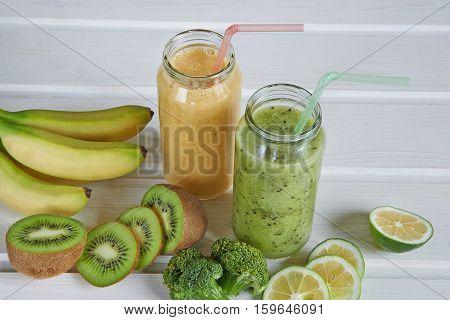 Smoothies of kiwi, mandarin, banana, Lemon and broccoli on a white background
