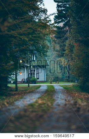 House In Autumn Forest With Driveway At Dusk. Exel. Achterhoek. Gelderland. The Netherlands.