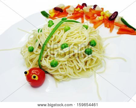 creative spaghetti food garnish with sausage lady-bug shape