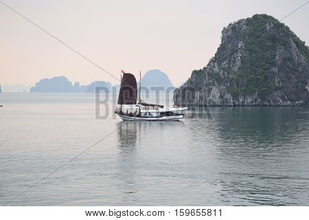HALONG BAY, VIETNAM - SEPTEMBER 16, 2016 - Tourist junk in Halong bay