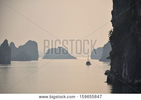Limestone karsts, isles and boats in Halong bay, Vietnam