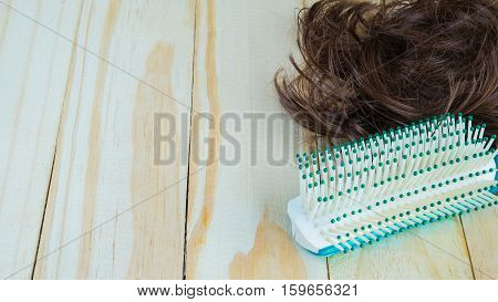 green comb and hair on wooden, Hairbrush on wooden