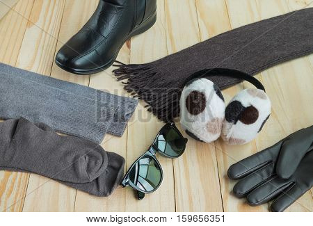 Winter accessories including clothing gloves boots scarf sunglasses hose and earmuff
