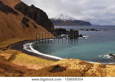 A hill view of volcanic bay on Adak against the Pacific Coast, Alaska. Dec 3