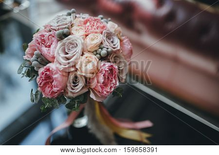 beautiful pink bridal flower bouquet with ribbons