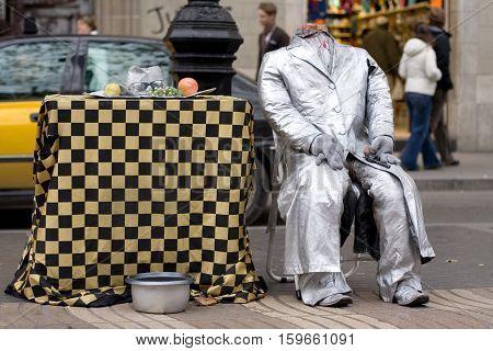 La Rambla Barcelona Spain. Street artist scene of suicide