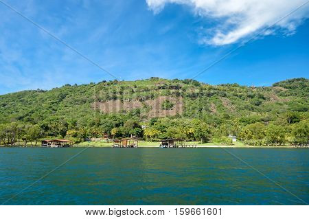 Beautiful coast and lush vegetation of the volcanic caldera Lake Coatepeque in Salvador. Central America