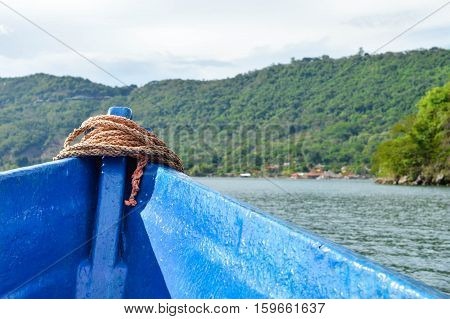 Landscape of the volcanic caldera Lake Coatepeque in El Salvador seen from the boat. Central America