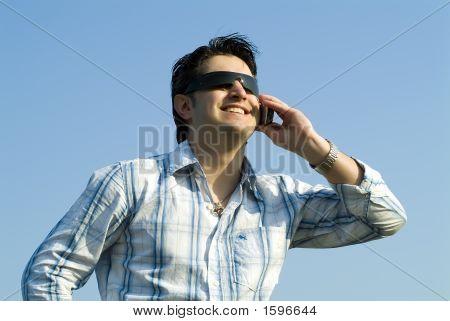 Young Man Having A Conversation
