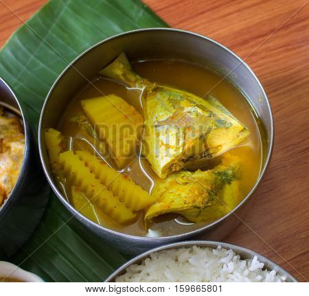 Thai foodYellow Curry with Fish and vegetable in a part of food carrier thai stye lauch jar.thai tiffin.