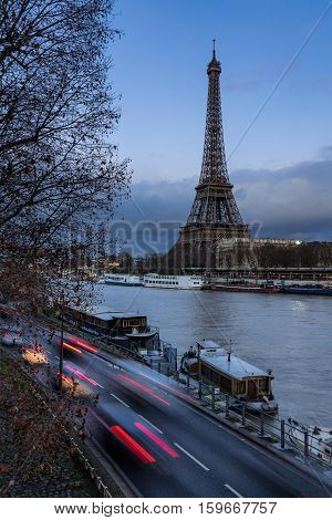 Eiffel Tower at twilight with the Seine River and car light trails. Paris Grenelle 7th Arrondissement France