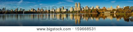 Fall in Central Park at the Jacqueline Kennedy Onassis Reservoir. Panoramic Early morning view on the Upper West Side Manhattan New York City
