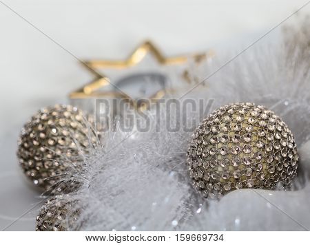 Balls encircled from a white garland and a a glass star.