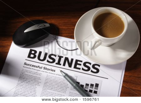 Coffee, Mouse Pen And Business File On Table