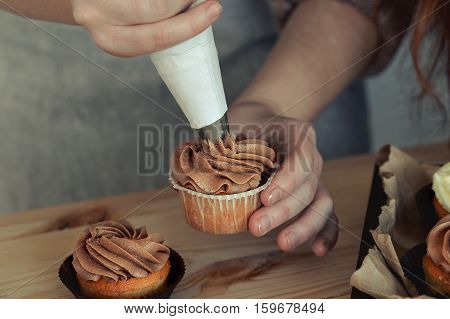 Woman pastry in the kitchen preparing sweet desserts