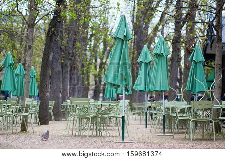 Empty Tables Of A Cafe In Luxembourg Garden
