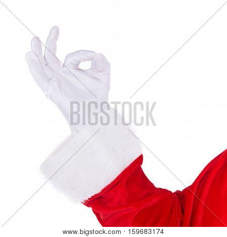 Santa Claus hand in white glove and red costume showing Okey O.K. sign gesture isolated on white background