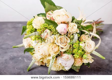 Bouquet of cream roses. Still life with colorful flowers. Fresh roses. Place for text. Flower concept. Fresh spring bouquet. Summer Background. Copyspace