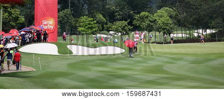 KUALA LUMPUR, MALAYSIA - OCTOBER 29, 2016: Spectators watch Jang Hana, Anna Nordqvist and Michelle Wie play at the 9th hole green of the TPC at the 2016 Sime Darby LPGA Malaysia golf tournament.