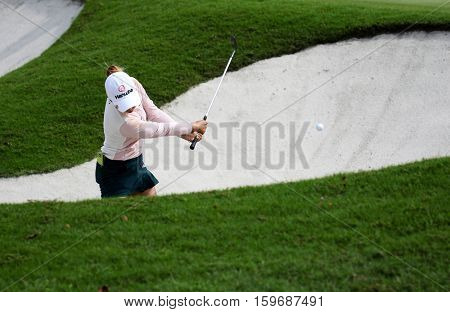 KUALA LUMPUR, MALAYSIA - OCTOBER 29, 2016: Jenny Shin of South Korea plays from the sand bunker of the TPC Golf Course at the 2016 Sime Darby LPGA Malaysia golf tournament.