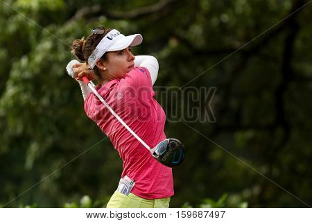 KUALA LUMPUR, MALAYSIA - OCTOBER 29, 2016: Gaby Lopez of Mexico tees off from the T-box of the 4th hole at the TPC Golf Course at the 2016 Sime Darby LPGA Malaysia golf tournament.