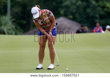 KUALA LUMPUR, MALAYSIA - OCTOBER 29, 2016: Ha Na Jang of South Korea putts at the green of the TPC Golf Course at the 2016 Sime Darby LPGA Malaysia golf tournament.