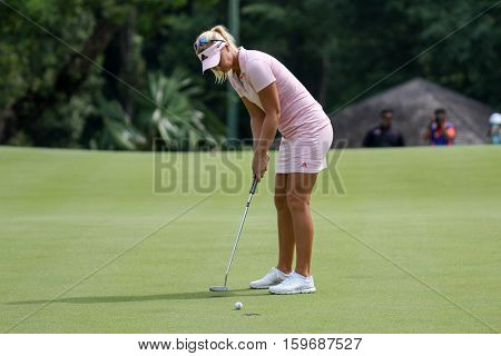 KUALA LUMPUR, MALAYSIA - OCTOBER 29, 2016: Anna Nordqvist of Sweden putts at the green of the TPC Golf Course at the 2016 Sime Darby LPGA Malaysia golf tournament.