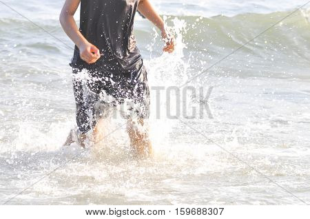 A girl Is running on the beach
