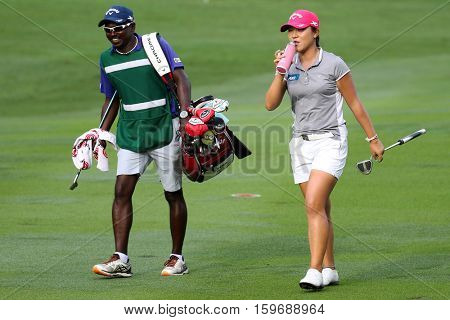 KUALA LUMPUR, MALAYSIA - OCTOBER 29, 2016: Lydia Ko of New Zealand check with her caddie on the fairway of the TPC Golf Course on Round 3 of the 2016 Sime Darby LPGA Malaysia golf tournament.