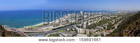 Panoramic view of Haifa Israel. City streets roads trees sea port and skyscrapers. Panorama in high size