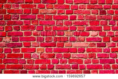 Stained Shabby Uneven Old Stucco Painted Red Brick Wall. Abstract Brickwall Background Texture. Vintage Style Wallpaper Close up
