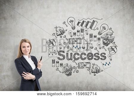 blonde business woman standing near to the business plan drawn
